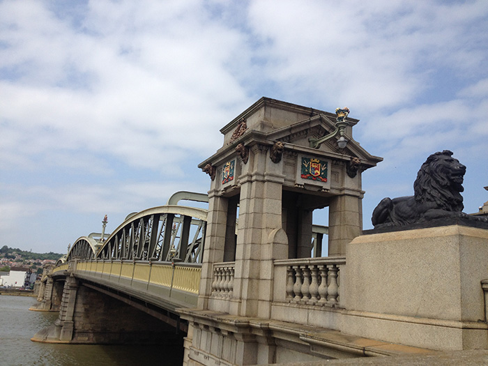 bridge lion sunny clouds
