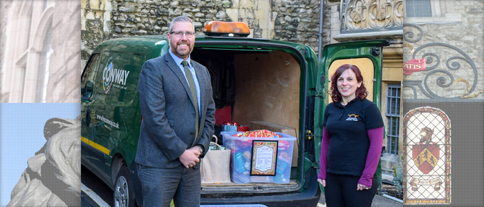 Matt Smith, Structures Director at FM Conway, receives the Rochester Bridge Trust's share of the food collection from Education Officer Caroline Chisholm.